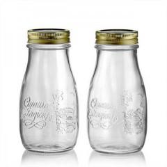 barattoli di vetro vuoti da usare per un' idea diy come centro-tavola con le pigne