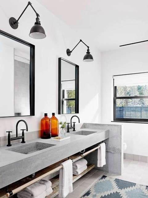 tendenza bagno stile scandinavo rubinetteria nera doppio lavandino in cemento