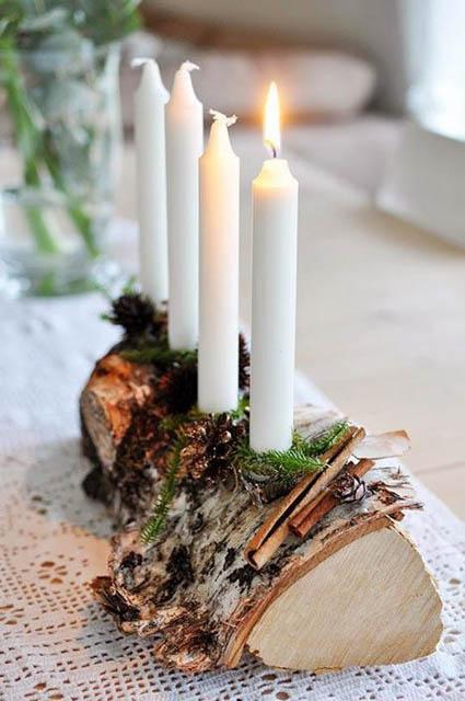 centro-tavola natalizio tronco con candele