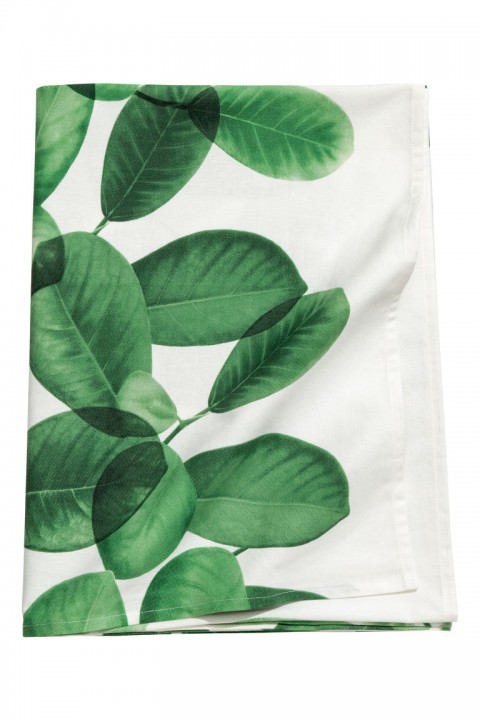 tovaglia bianca con grandi foglie verdi h&m home